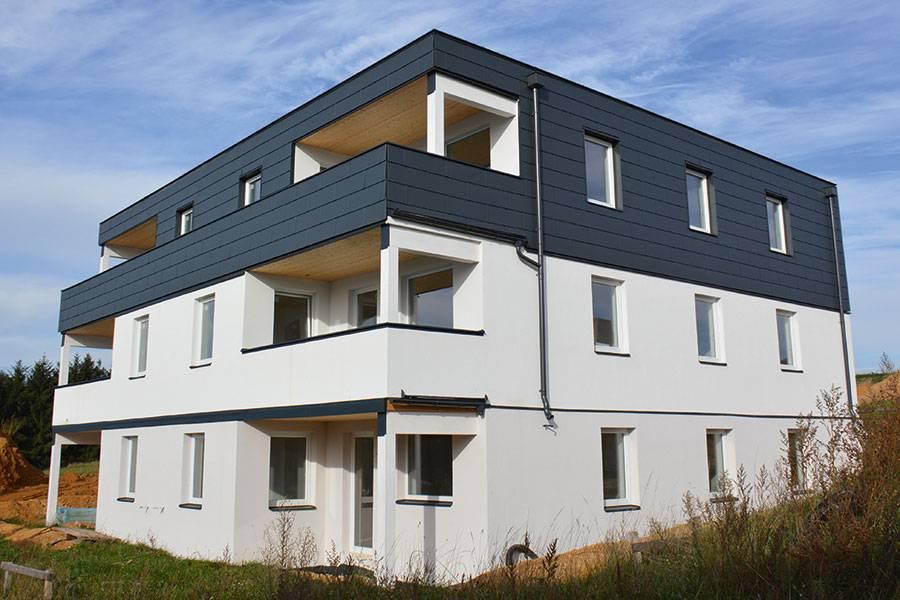 Amade Antracit – Bloc locuințe, Austria